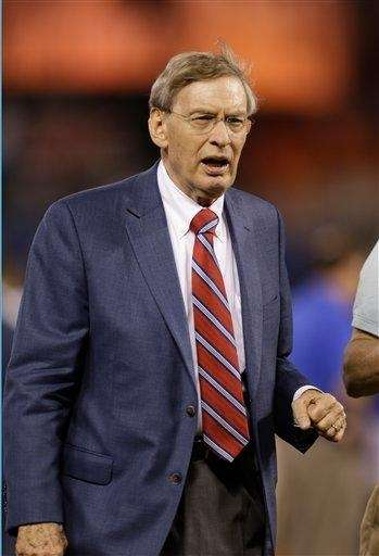 Major League Baseball Commissioner Bud Selig walks out