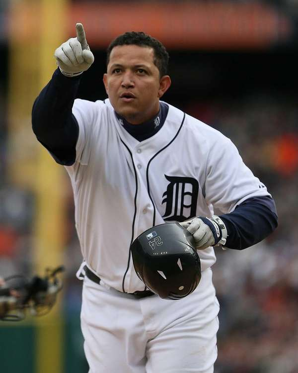 Miguel Cabrera points to the crowd after hitting