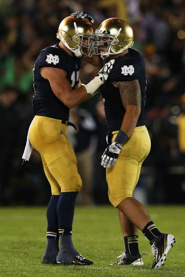 Notre Dame safety Zeke Motta and linebacker Manti