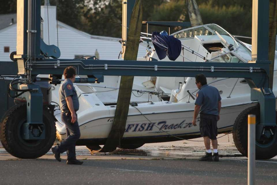 The 21-foot Cobia Fish Tracker, which overturned two