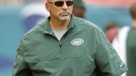 Jets offensive coordinator Tony Sparano looks on as