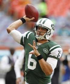 Mark Sanchez throws the ball prior to a