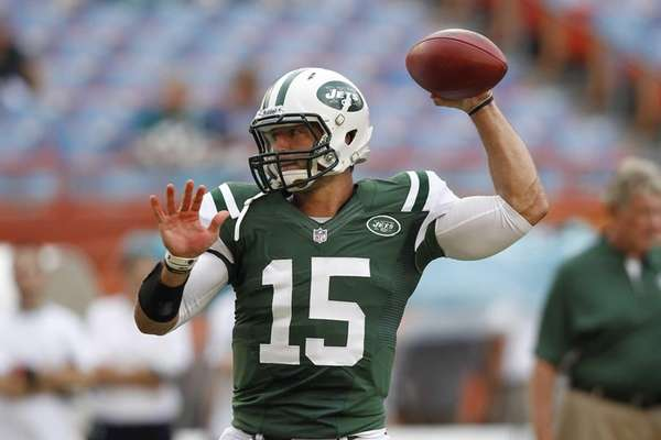 Tim Tebow throws the ball prior to a