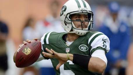 Jets quarterback Mark Sanchez looks to pass during