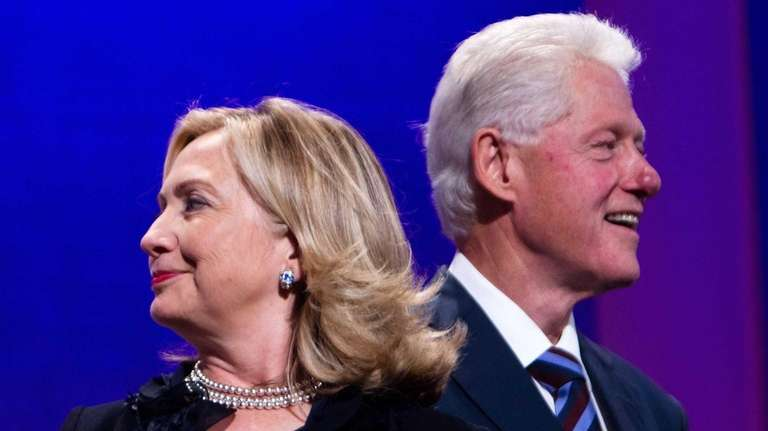 President Bill Clinton, right, stands on stage with