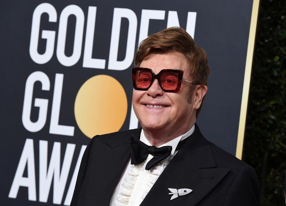 Elton John arrives at the 77th annual Golden