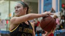 St. Anthony's Colleen McCullagh works against a Moore