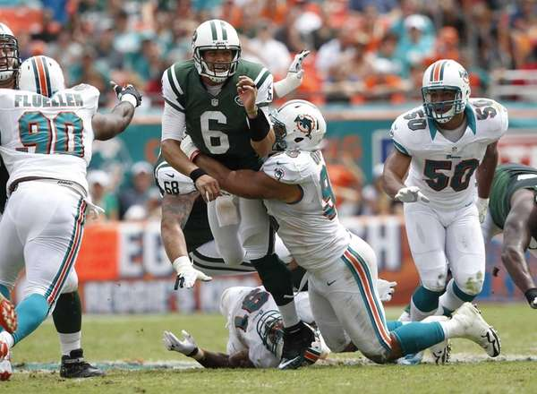 Jared Odrick of the Miami Dolphins hits Jets
