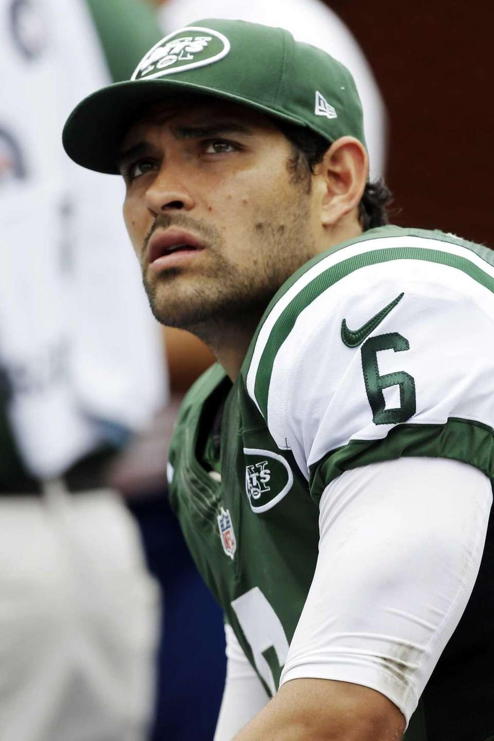 Jets quarterback Mark Sanchez looks up from the