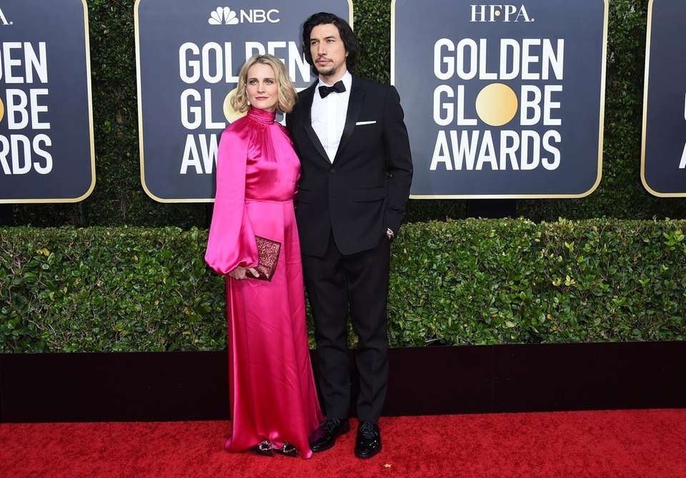 Adam Driver, right, and Joanne Tucker arrive at