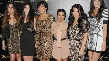 Kris Jenner, center, and her daughters, from left,