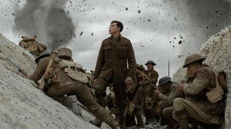 """George MacKay, center stars in """"1917,"""" co-written and"""