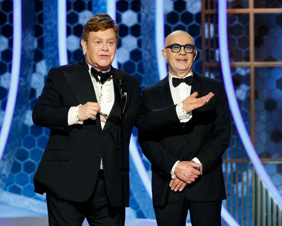 This image released by NBC shows presenters Elton