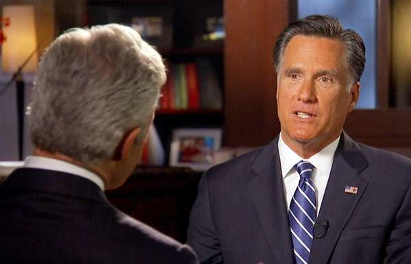 Mitt Romney, right, is interviewed by