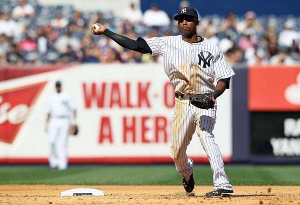Eduardo Nunez throws to first base during a