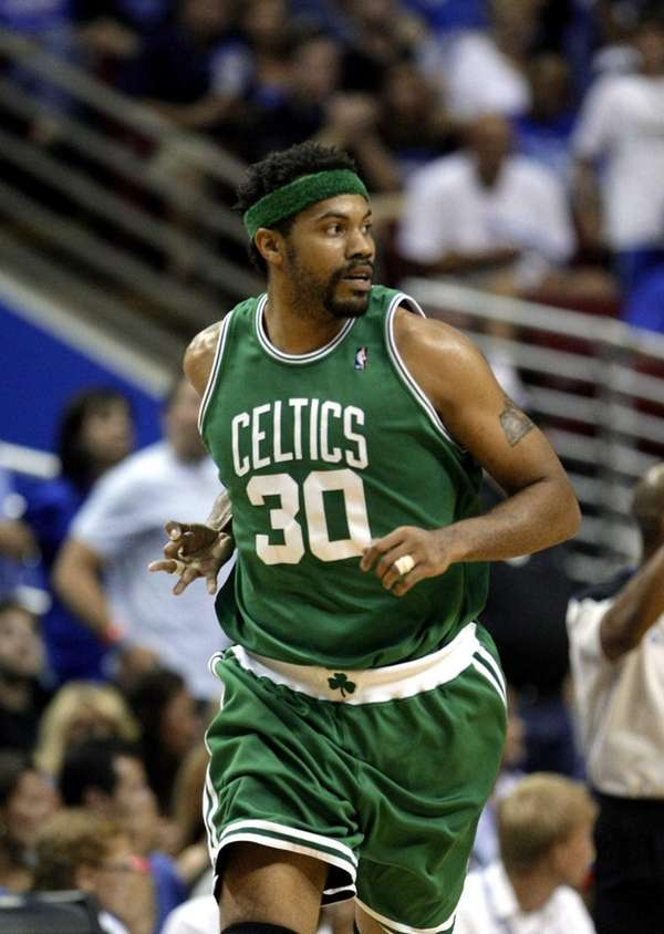 Boston Celtics center Rasheed Wallace runs down the