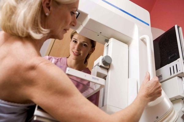 A patient receives a mammogram.