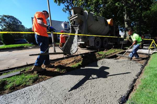 Construction crews work on the streets of New