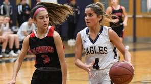 BethpageÕs Izzy Sierra drives to the basket defended