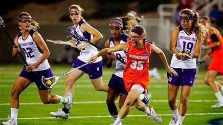 Syracuse's Michelle Tumolo is surrounded by Northwestern's Lacey