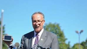 Senator Charles Schumer speaks, with a GPS in