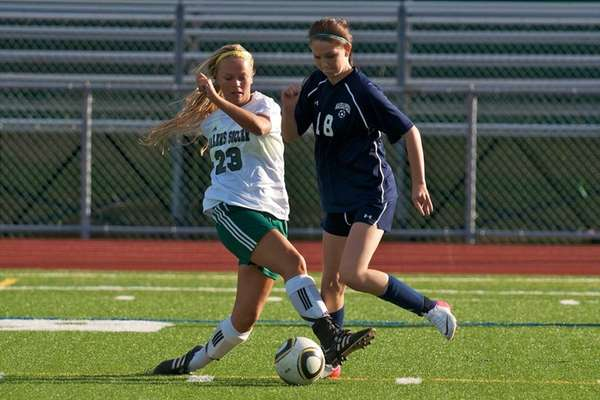 Massapequa junior Taylor Howard battles Farmingdale senior Amanda