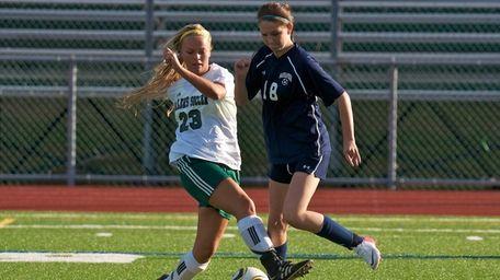 Massapequa junior Taylor Howard battles Farmingdale senior Amanda