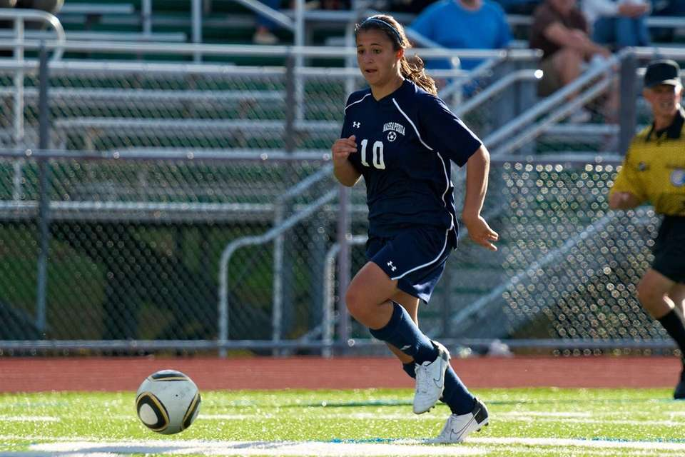 Massapequa senior Erica Modena makes a play on