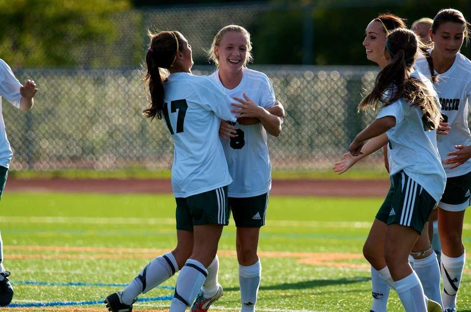 Farmingdale senior Maggie Fleming celebrates with teammates after