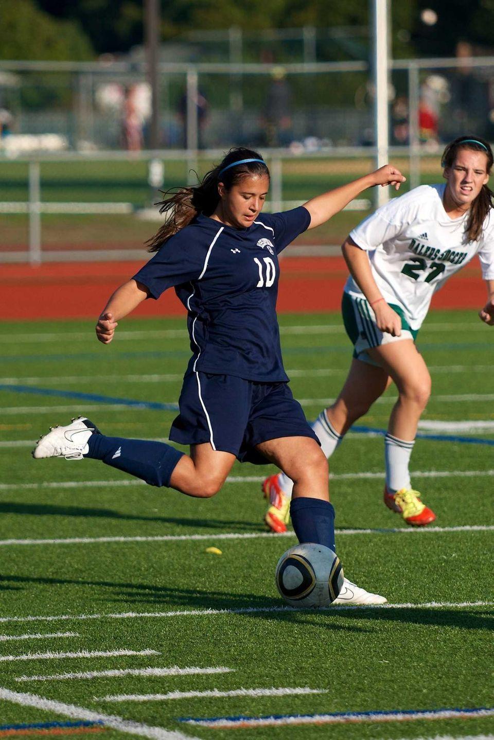 Massapequa senior Erica Modena sends the ball toward