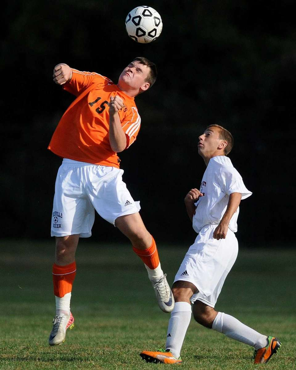 Hicksville's Matthew Sloan goes up for a header