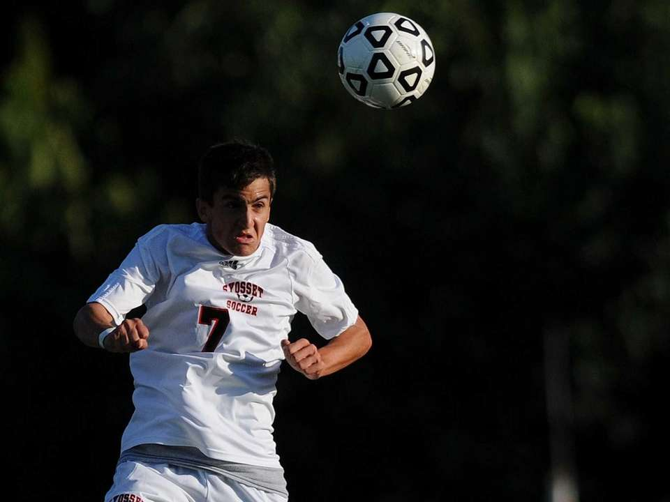 Syosset's Scott DeBenedittis makes a header during the