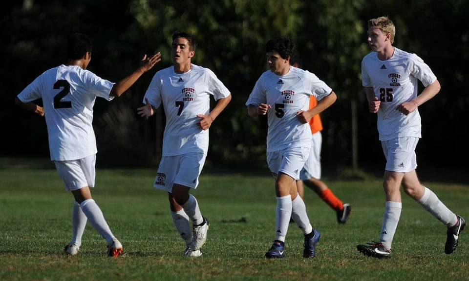 Syosset's Scott DeBeneditto, second from left, gets congratulated