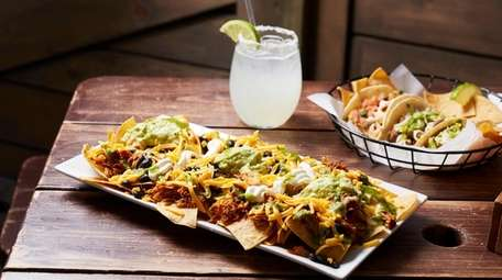 The pulled pork nachos as served at Swell
