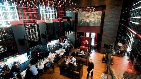 The second-floor dining room overlooks the bar and