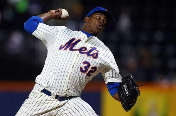 Jenrry Mejia pitches in a game against the
