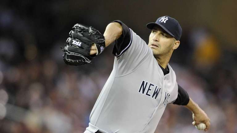 Andy Pettitte delivers a pitch in a game