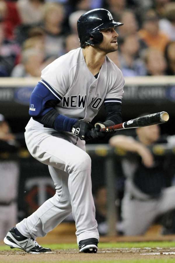 Nick Swisher watches his two-run home run off