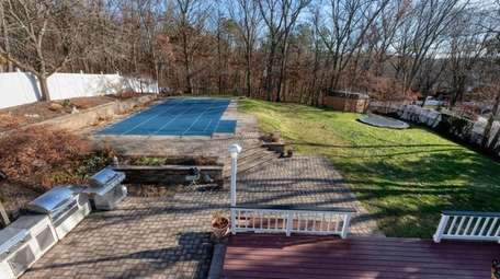 The backyard comes with a paver patio, an