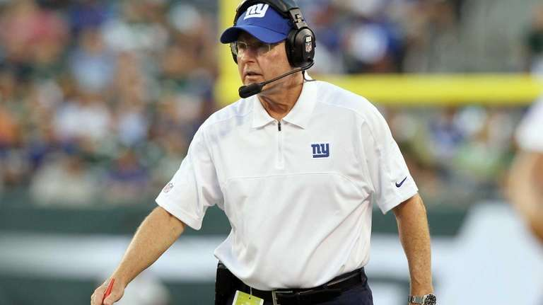 Head coach Tom Coughlin gives direction on the