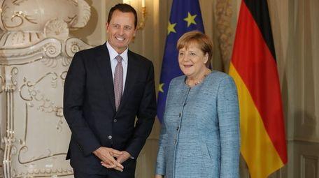 U.S. Ambassador Richard Grenell and Chancellor Angela Merkel