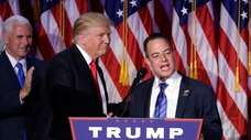 Reince Priebus, right, President Donald Trump's first chief