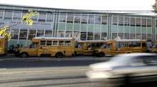 Cars pass Our Lady of Mercy School in