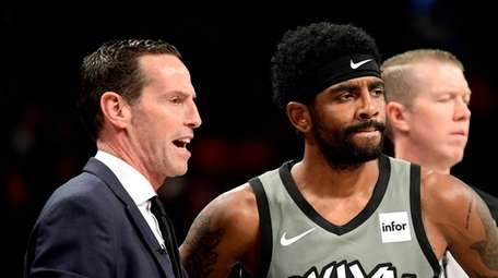 Nets head coach Kenny Atkinson speaks with Kyrie