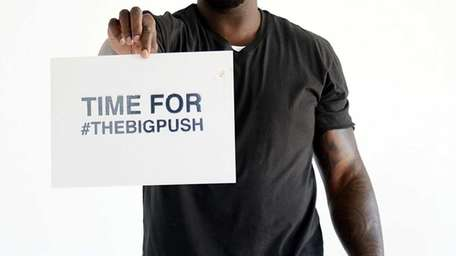 Shaquille O'Neal poses for photos before he leads