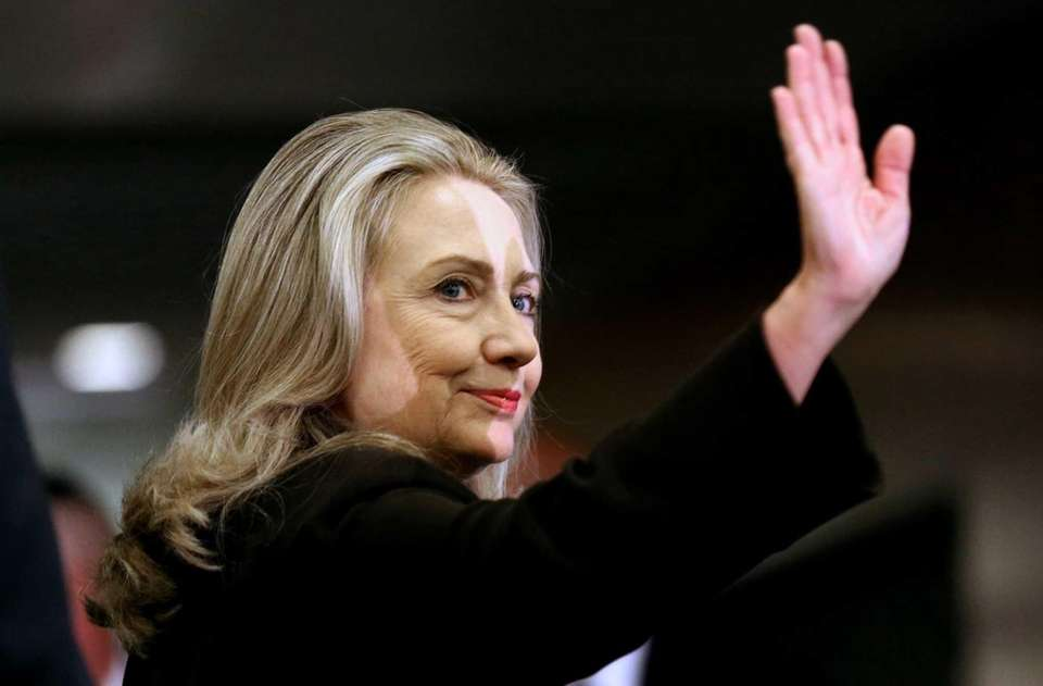 Secretary of State Hillary Rodham Clinton waves as