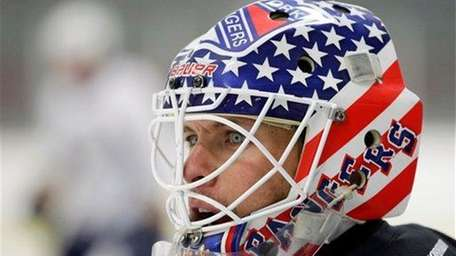 Martin Biron looks on during an informal NHL