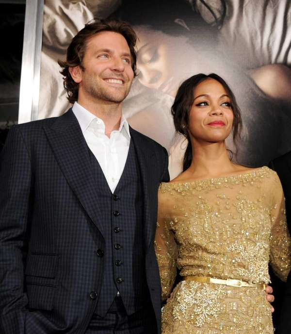 Actors Bradley Cooper and Zoe Saldana arrive at