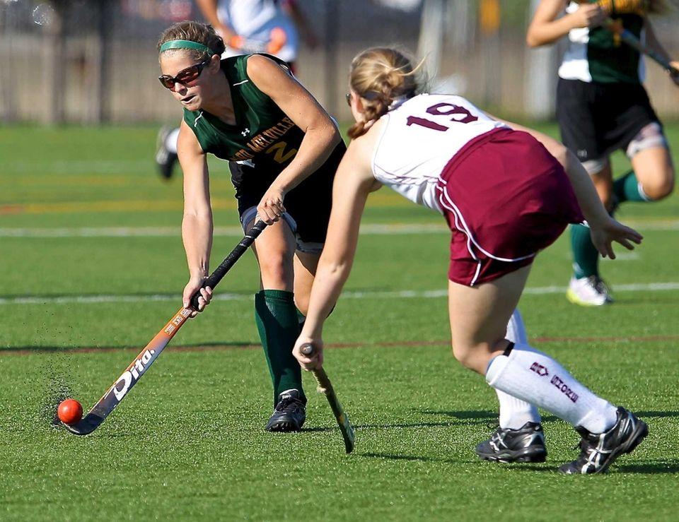 Ward Melville's Liz Conley shoots the ball past