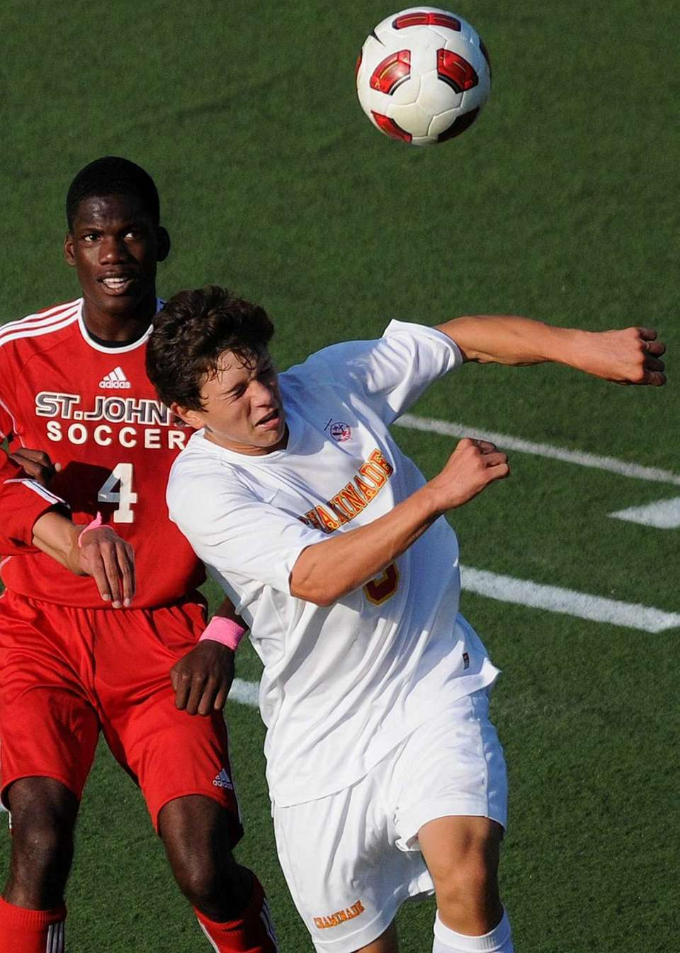 Chaminade's Nicholas Joesten, right, heads a ball away
